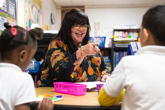 Price Elementary reading recovery instructor Jill Cole reacts to a correct answer during a small group spelling session Monday. Oct. 15, 2018
