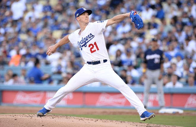 Oct 15, 2018; Los Angeles, CA, USA; Los Angeles Dodgers starting pitcher Walker Buehler (21) pitches in the second inning against the Milwaukee Brewers in game three of the 2018 NLCS playoff baseball series at Dodger Stadium. Mandatory Credit: Gary A. Vasquez-USA TODAY Sports