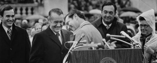 "In this photo from Dec. 7, 1971, Dee Huddleston, center, was embarrassed after introducing Gov. Wendell Ford as ""William."" But Ford, on left, and outgoing Gov. Louie Nunn, right, laughed."