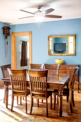 The dining area inside Michele Mercer's home on Monday, Oct. 8, 2018, in Okemos. The 2,000-square-foot Queen Anne Victorian house is on just under two acres and was built in 1893.