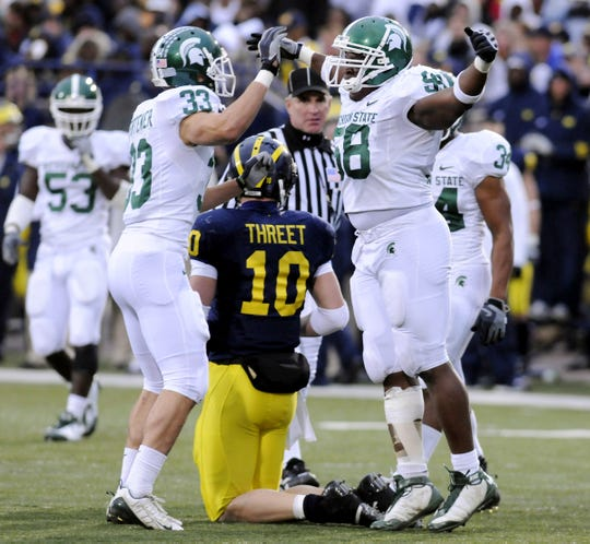 MSU's Danny Fortener, left, and Trevor Anderson celebrate Anderson's sack of Michigan's Steven Threet during the Spartans' 35-21 win in 2008.