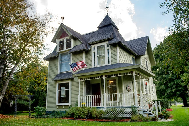 Michele Mercer's home photographed on Monday, Oct. 8, 2018, in Okemos. The 2,000-square-foot Queen Anne Victorian house is on just under two acres and was built in 1893.