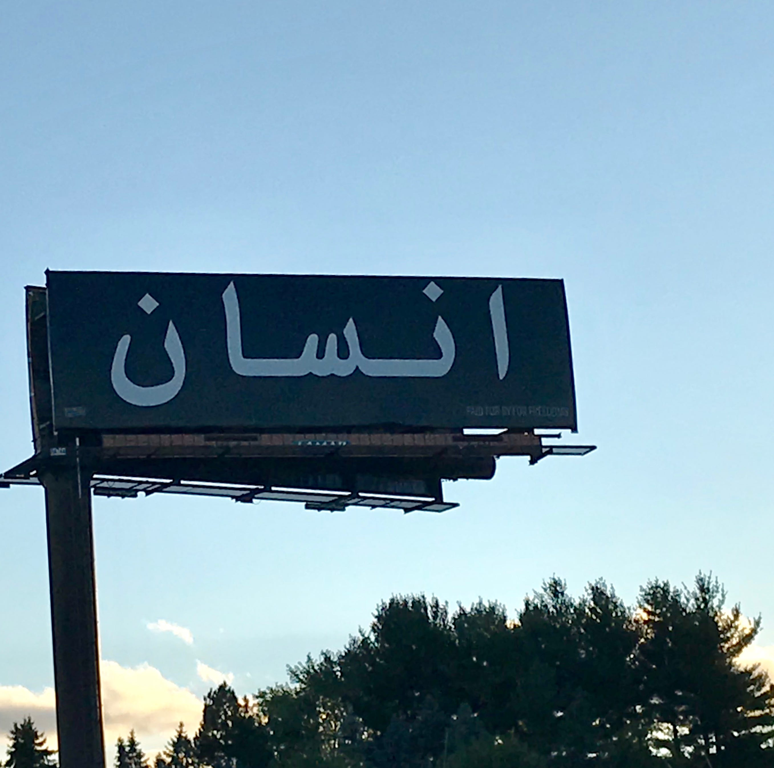Arabic billboard near Lansing has people wondering: What does it mean?