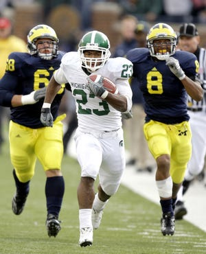 Michigan State's Javon Ringer races away from Michigan's Mike Martin and Jonas Mouton for a touchdown during the Spartans' 35-21 win over the Wolverines in 2008 in Ann Arbor.