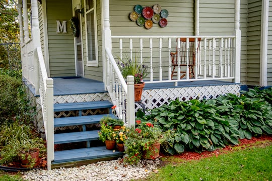 The stairs and front porch leading to the front door of Michele Mercer's home on Monday, Oct. 8, 2018, in Okemos. The 2,000-square-foot Queen Anne Victorian house is on just under two acres and was built in 1893.