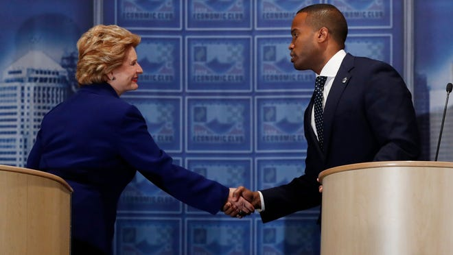 Sen. Debbie Stabenow, D-Mich., left,and challenger John James shake hands after their debate at the Detroit Economic Club, Monday, Oct. 15, 2018, in Detroit. Stabenow is seeking a fourth term and has led comfortably in polls, and James, a business executive and combat veteran, participated in their second debate before the November election.