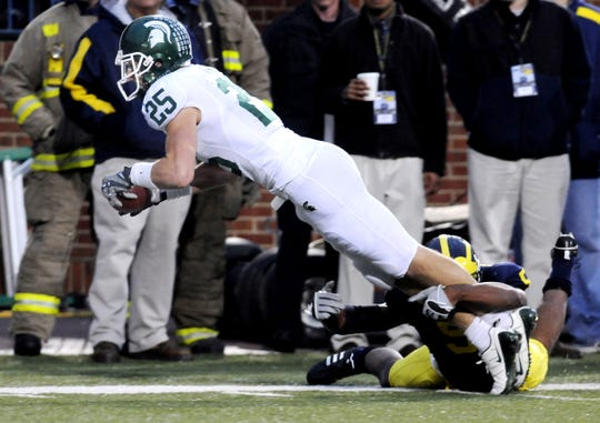 Blair White picks up a key first down late in MSU's 35-21 win over Michigan in 2008.