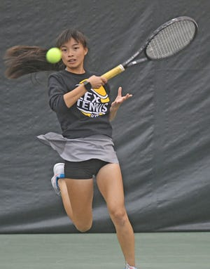 Lexington freshman Gracie Pfieffer whacks a forehand in Monday's showdown with Toledo Central Catholic in the district finals of the Ohio Tennis Coaches Association Team Tournament.