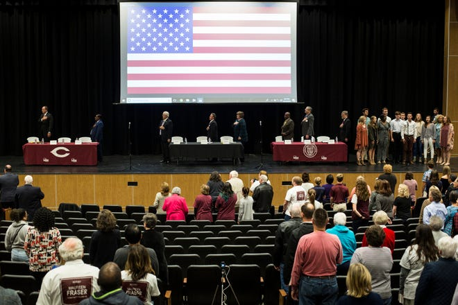 October 15 2018 - Candidates running for Collierville Alderman, School Board, and State Representative District 95 stand during the national anthem before the start of a Leadership Collierville forum Monday night at Collierville High School.