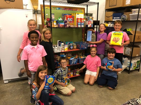 Fourth-grade gifted program students at Center Hill Elementary pose for a photo at the pantry. Center Hill students started a Blessing Box to help those in need.