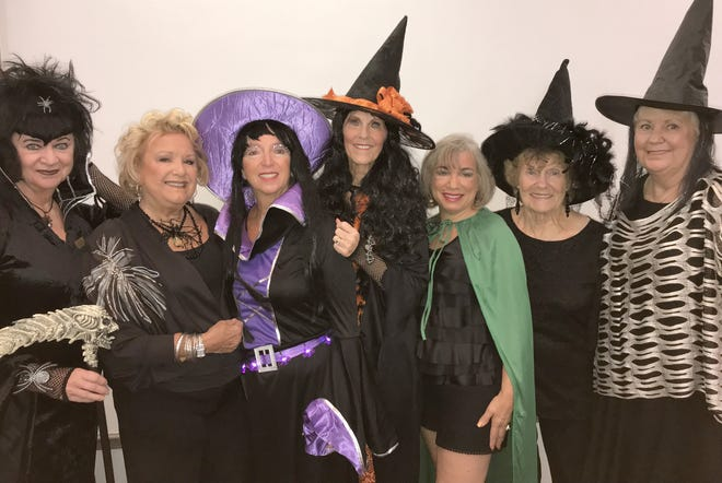 Cindy Crane, Ruth Lee DeVaughn, Rose Kraemer, Susie Walsh, Annette Mennella, MaryAnn Cassidy and Hildie Kyes rode their brooms to the luncheon.