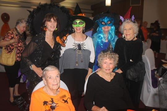 Enjoying the friendship of fellow witches are, seated: Pat Schimek and Evelyn Case; standing: Carla Mickes, Ann Faroul, Betty Richardson and Doris Kosley.