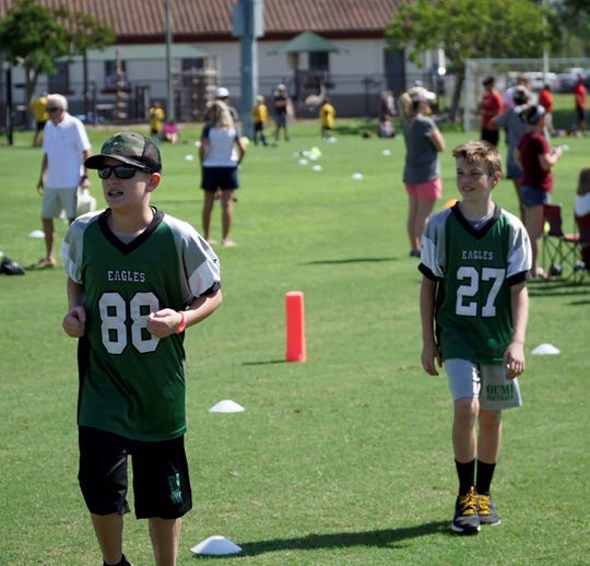 The Marco Island Eagles Tackle Football team joined forces with the Optimist Club of Marco Island.