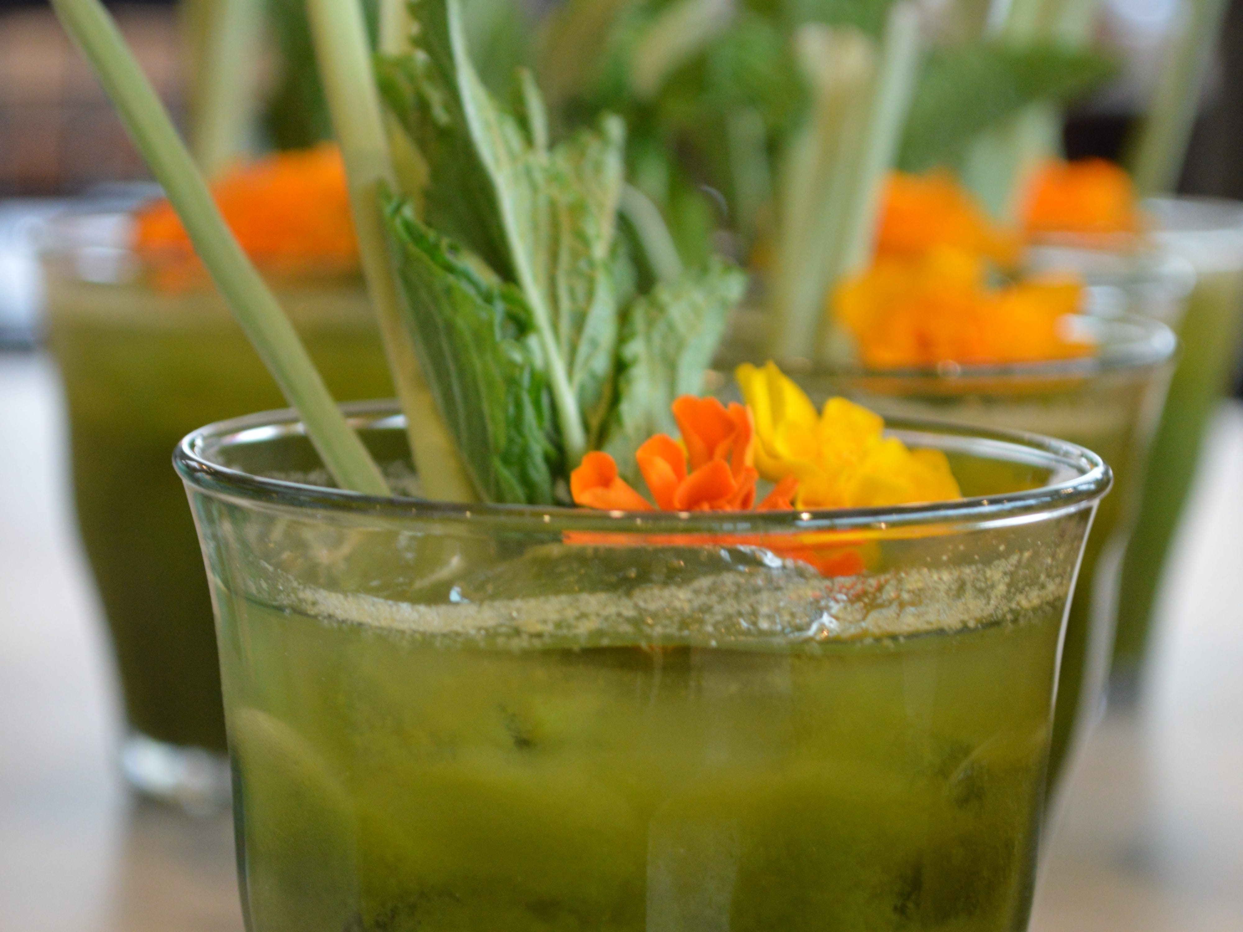Goddess and The Baker's kale apple cooler is made with kale, Fuji apple, cucumber and lemon.