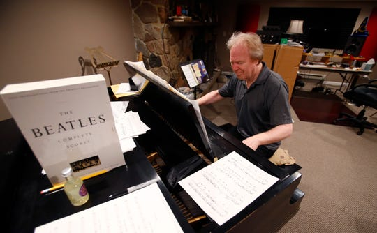 """Terry Sweet has a choice of a baby grand piano or an electronic keyboard in a basement studio where he has created jingles for customers like Colder's, Steins Garden and Gifts, and the Milwaukee Brewers' """"Turnin' Up the Heat."""""""
