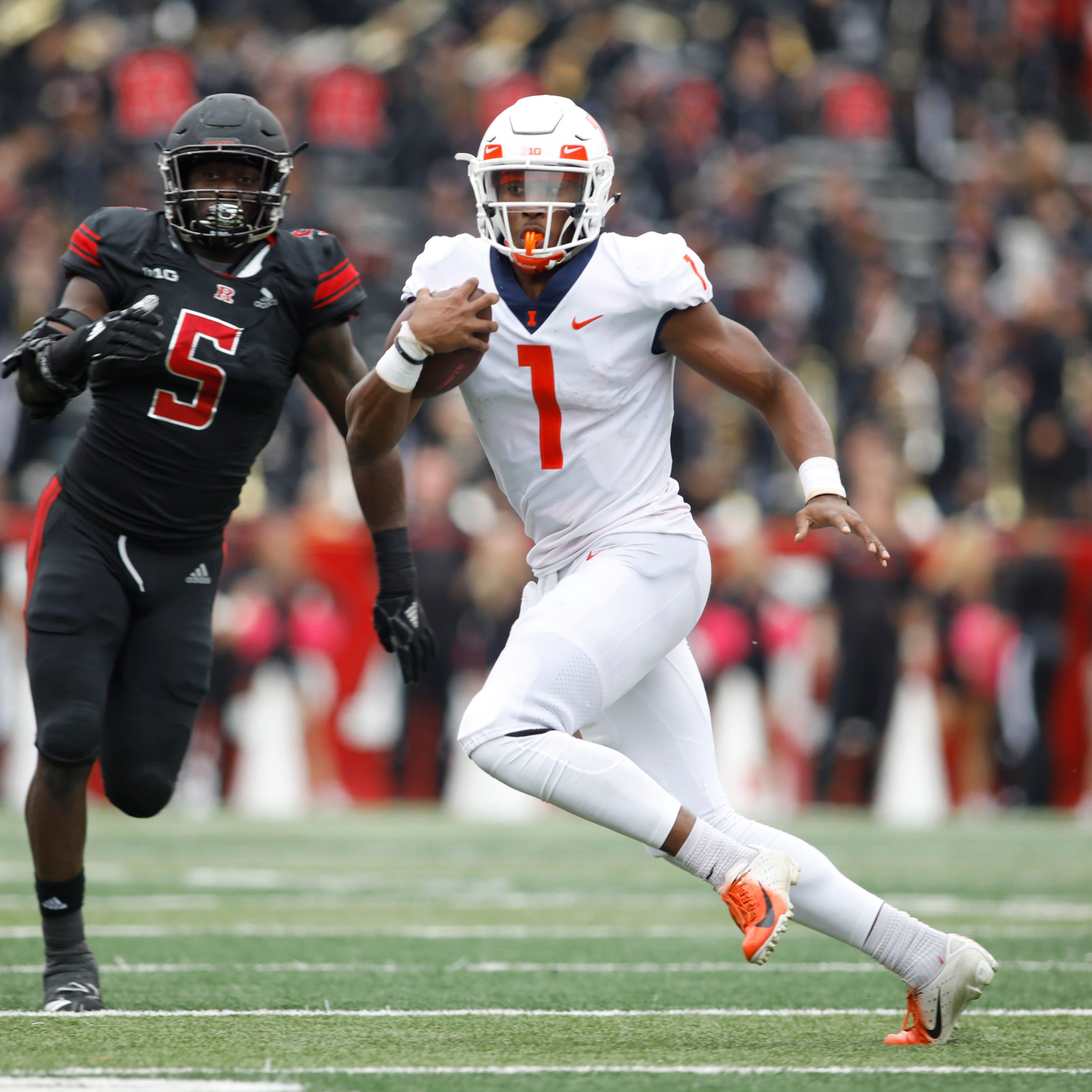 Illinois quarterback AJ Bush Jr. runs with the...