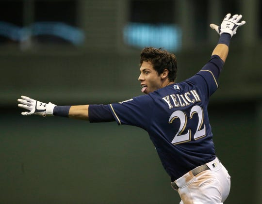 Christian Yelich reacts after driving in the game-winning run against the Chicago Cubs on Sept. 3.