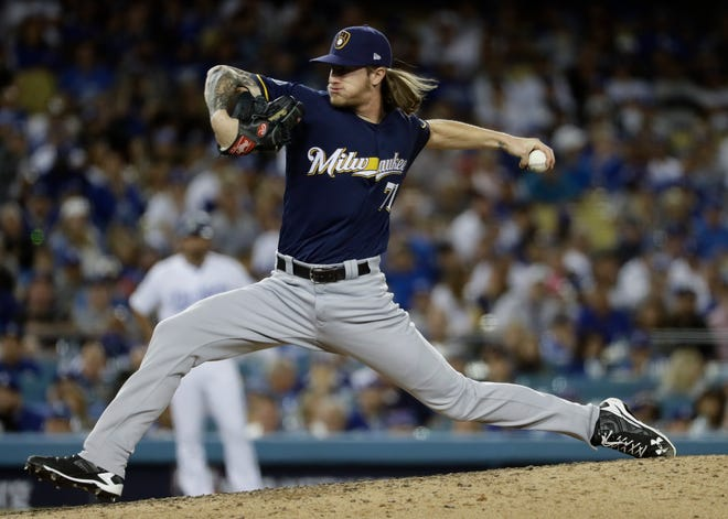 Brewers ace reliever Josh Hader fans both Dodgers batters he faces in the eighth inning of Game 3 on Monday night, earlier this week.