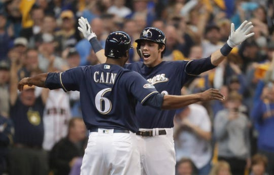 Christian Yelich celebrates his two-run home run with Lorenzo Cain in Game 1 of the NLDS.