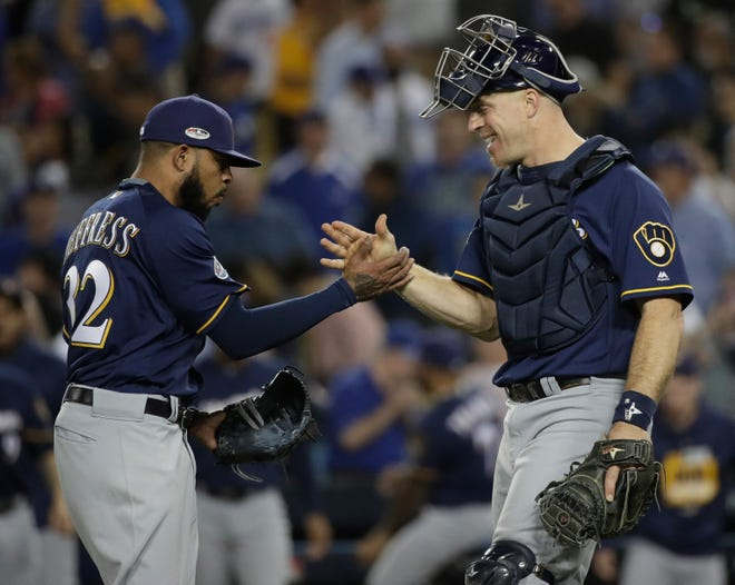 Brewers catcher Erik Kratz celebrates with reliever Jeremy Jeffress after the Brewers shut down the Los Angeles Dodgers, 4-0, in Game 3 of the National League Championship Series.