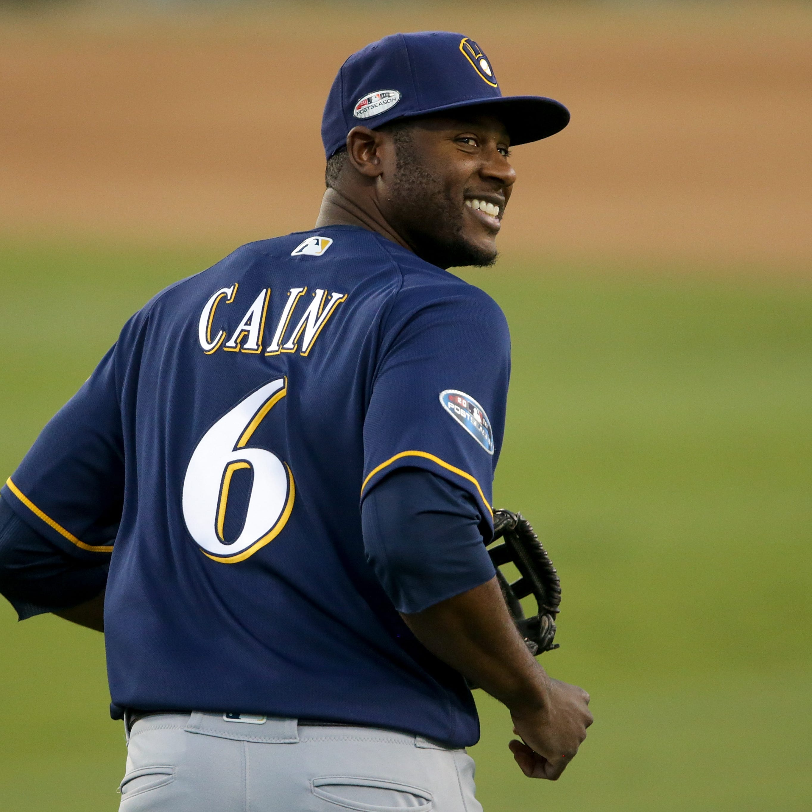 Lorenzo Cain has plenty to take in as he reports to Brewers camp on Monday