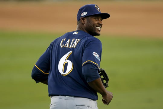 Brewers centerfielder Lorenzo Cain Is all smiles as heads back to the dugout after the Dodgers' final out of the bottom of the fourth inning of Game 3 on Monday night.