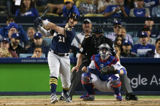 Travis Shaw of the Milwaukee Brewers hits a triple in the sixth inning against the Los Angeles Dodgers in Game 3 of the National League Championship Series at Dodger Stadium on October 15, 2018 in Los Angeles, California.