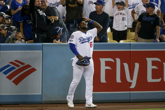 Dodgers rightfielder Yasiel Puig reacts after Orlando Arcia's home run lands in the stands out of his reach during the seventh inning of Game 3 on Monday night.