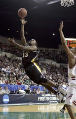 UWM's Joah Tucker puts up an off balance shot for two points in the second half against Alabama on Thursday, March, 17, 2005.