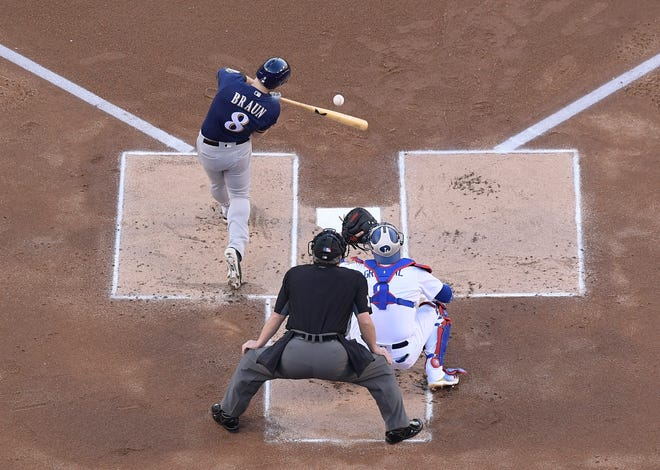 Ryan Braun sends a double to left field to drive in Christian Yelich for the first run of the game for the Brewers' Game 3 contest against the Dodgers on Monday.