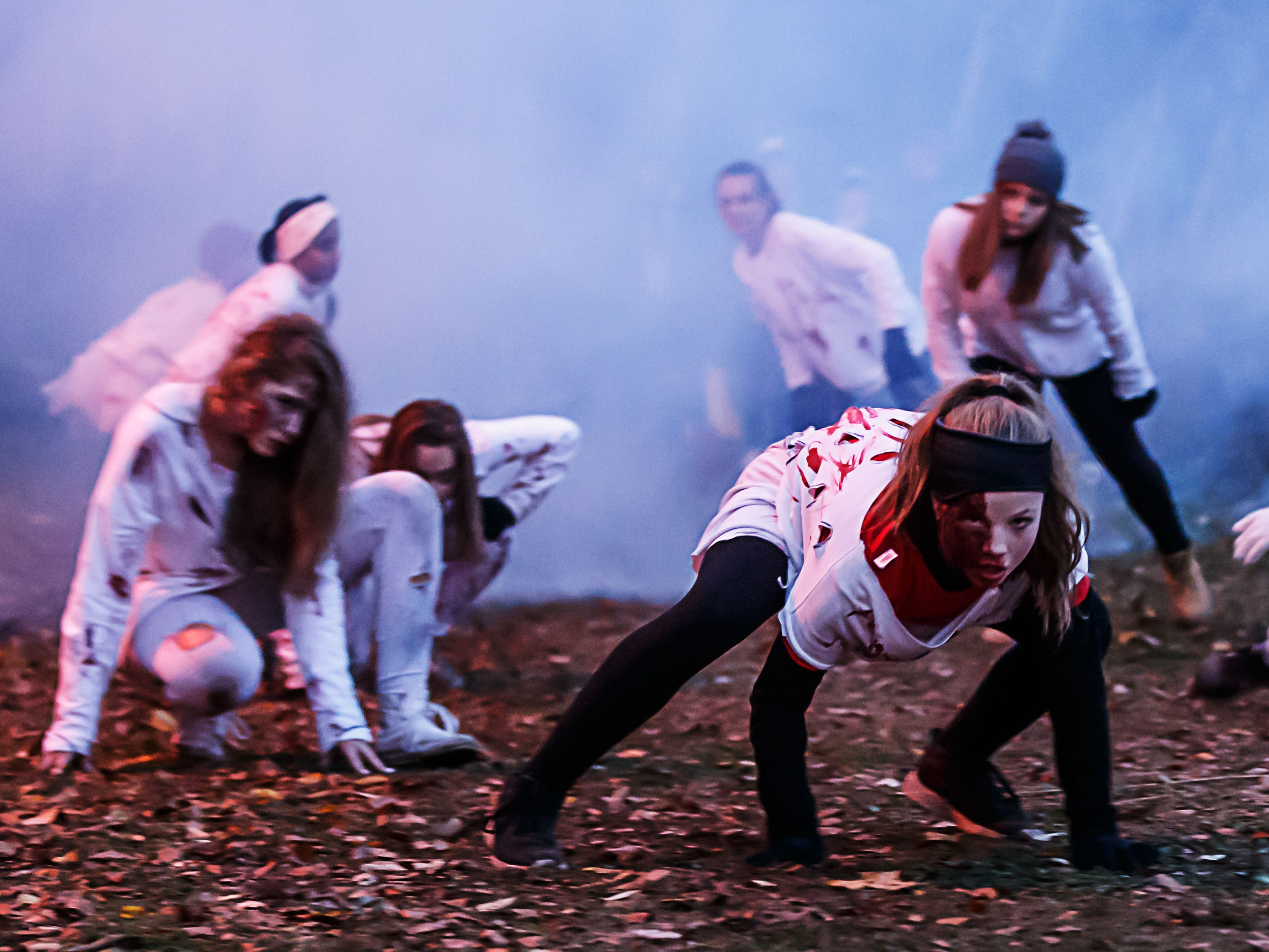 Zombies from the Waukesha Xtreme Dance Team emerge from a foggy trail during the 21st annual Fright Hike at Lapham Peak State Park in Delafield on Saturday, Oct. 13, 2018. The two-night event, hosted by the Friends of Lapham Peak, features a 1-mile walk through the dark forest riddled with ghosts and goblins followed by live music, a bonfire, concessions and more.