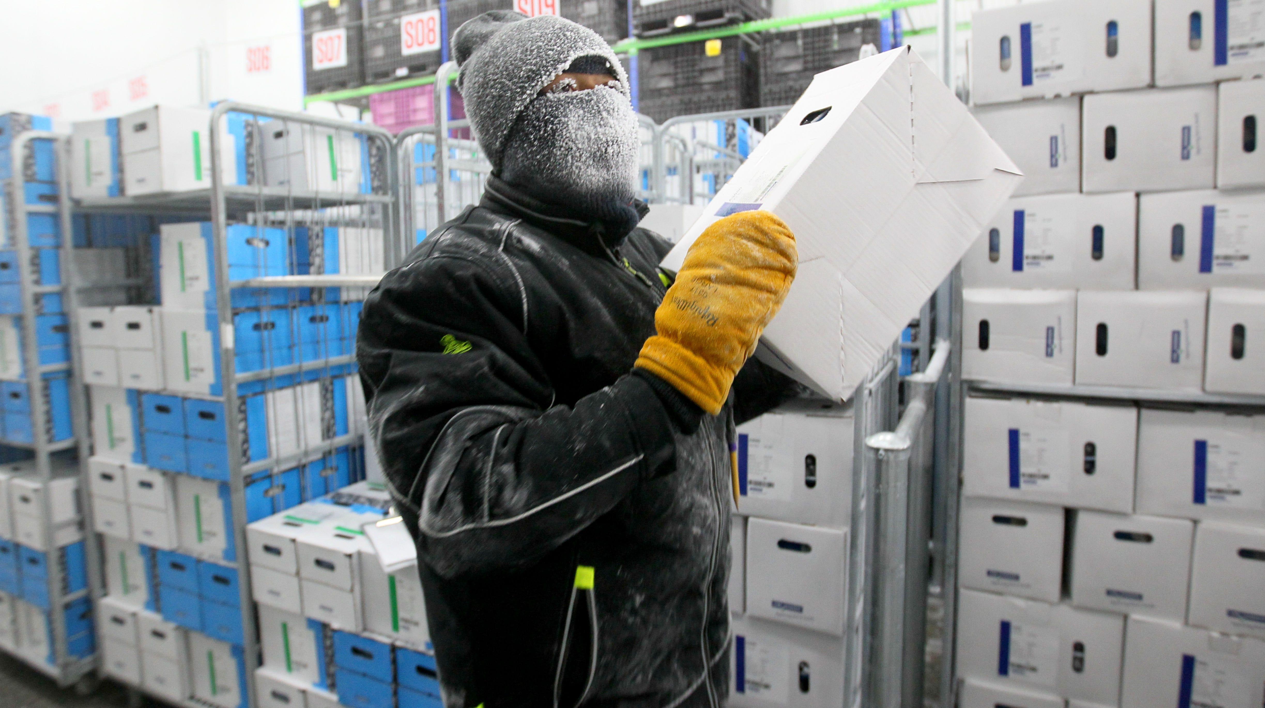 Kenny Jolliff, a freezer operator, picks orders...