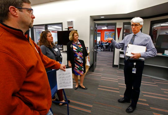 Principal Michael Comiskey describes how a seventh grade house instructors adjust a day or week's schedule for all of its classes to allow for labs and projects at Kettle Moraine Middle School on Oct. 16.