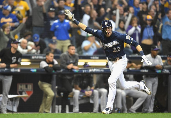 Christian Yelich scores the winning run in Game 1 of the NLDS.