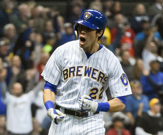 Brewers right fielder Christian Yelich reacts after hitting a solo home run in the seventh inning against the Tigers.