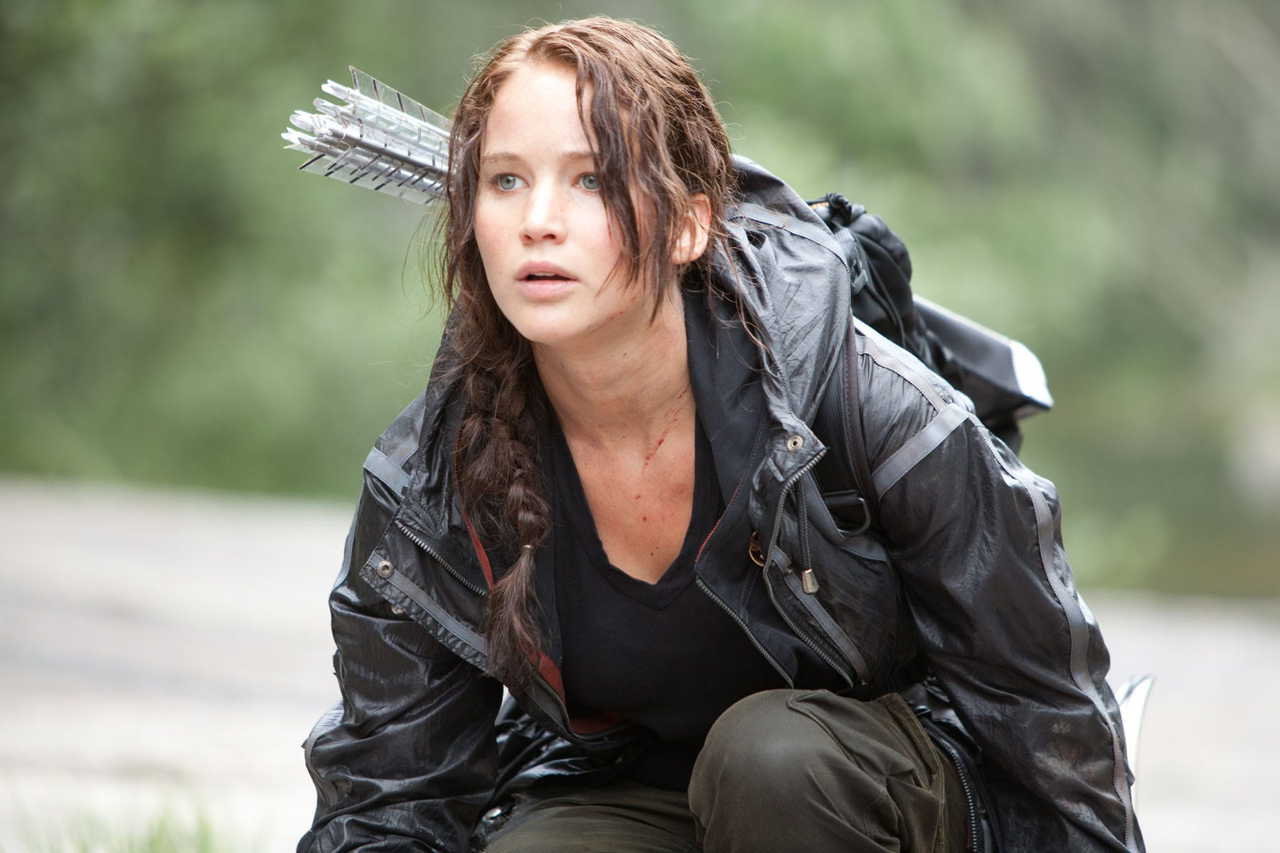 """Katniss Everdeen (Jennifer Lawrence) fights for her life and, to her surprise, a lot more in the first """"Hunger Games"""" movie."""