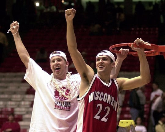 Wisconsin's Jon Bryant, left, and Mike Kelley (22) celebrate after cutting down the nets following Wisconsin's 64-60 NCAA West Regional win over Purdue Saturday, March 25, 2000, in Alburuerque, N.M.