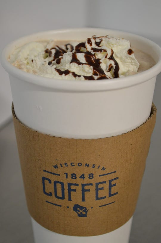 A barbajada is half brewed coffee and half hot chocolate that's topped with whipped cream. It costs $3.15 for 12 ounces, $3.55 for 16 ounces and $3.95 20 ounces.