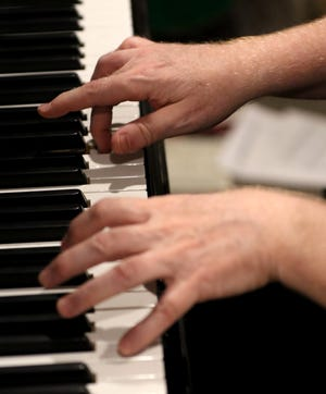 """Terry Sweet has a choice of a baby grand piano or an electronic keyboard to create jingles in a basement studio for customers like Colder's, Steins Garden and Gifts, and the Milwaukee Brewers """"Keep Turning Up The Heat,"""" which has found newfound fame with Brewer's tune being used in viral videos."""