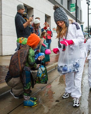 Maddie Christiansen hands out goodies during the 2015 Halloween Parade in downtown Oconomowoc. This year's parade is scheduled for 4 p.m. Saturday, Oct. 27.