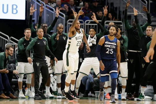 Sterling Brown and his Bucks teammates celebrate one of 25 made three-pointers against the Timberwolves in the final preseason game Friday.