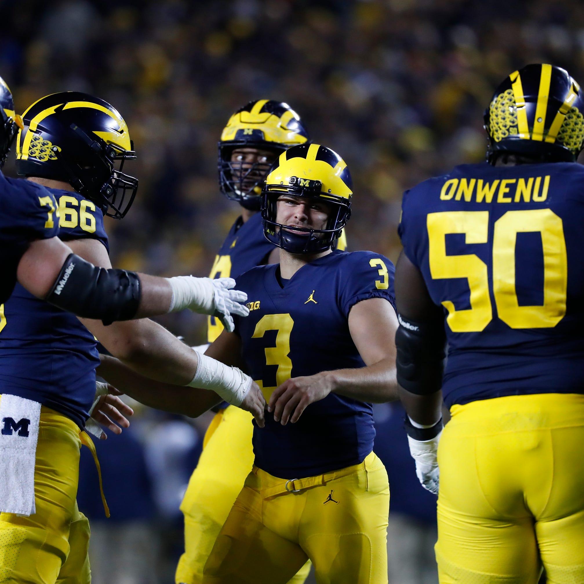 Michigan place kicker Quinn Nordin (3) is...