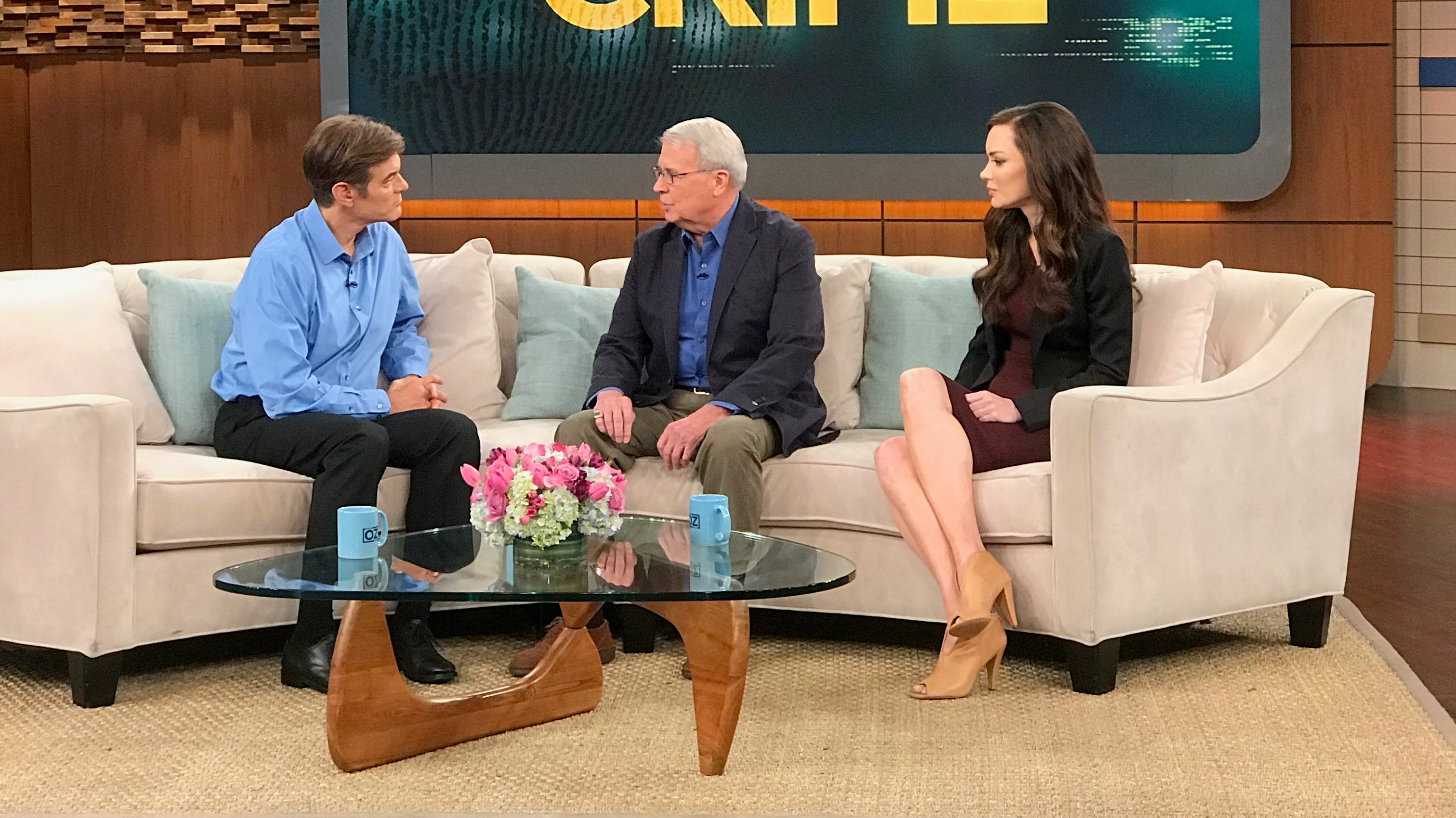 """Local dentist Dr. Larry Gould (center) talks with Dr. Mehmet Oz (left) about the unsolved murder of Gould's daughter, Rebekah, in this photograph from the set of """"The Dr. Oz Show."""" The episode was filmed in New York City last week and also included private investigator and writer Catherine Townsend (right), who is hosting a podcast focusing on the unsolved case."""