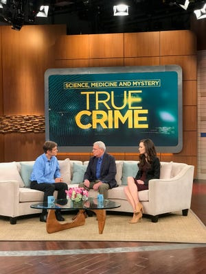 "Local dentist Dr. Larry Gould (center) talks with Dr. Mehmet Oz (left) about the unsolved murder of Gould's daughter, Rebekah, in this photograph from the set of ""The Dr. Oz Show."" The episode was filmed in New York City last week and also included private investigator and writer Catherine Townsend (right), who is hosting a podcast focusing on the unsolved case."