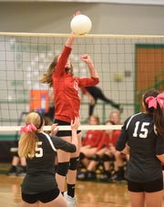 Flippin's Brenna Metts tips the ball over the net against Izard County on Monday night.