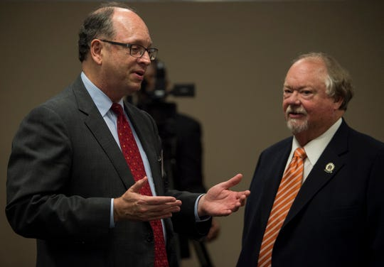 Democratic candidate for Alabama Chief Justice Bob Vance, left, speaks with Circuit Judge Jimmy Pool during the Montgomery County Democrats meeting in Montgomery, Ala., on Monday, Oct. 15, 2018.