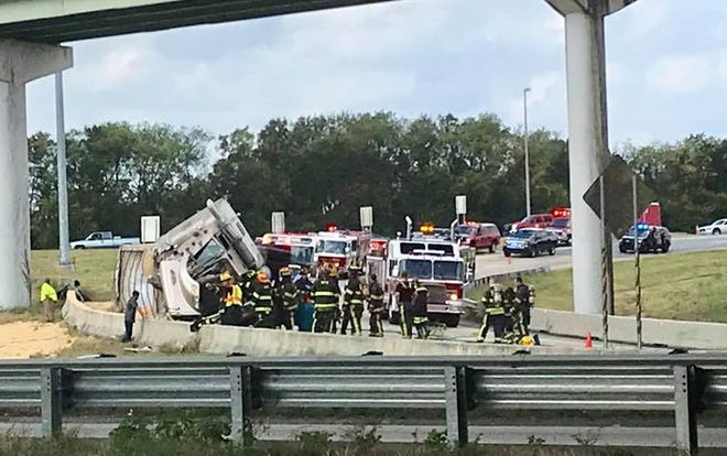 Units are currently working an overturned 18 wheeler at the I-65 South/ I-85 North interchange.