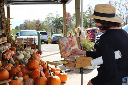 Artist Barbara Davis works at the 2017 Pike Road Plein Air Paint Out Quick Draw Competition at SweetCreek Farm Market.