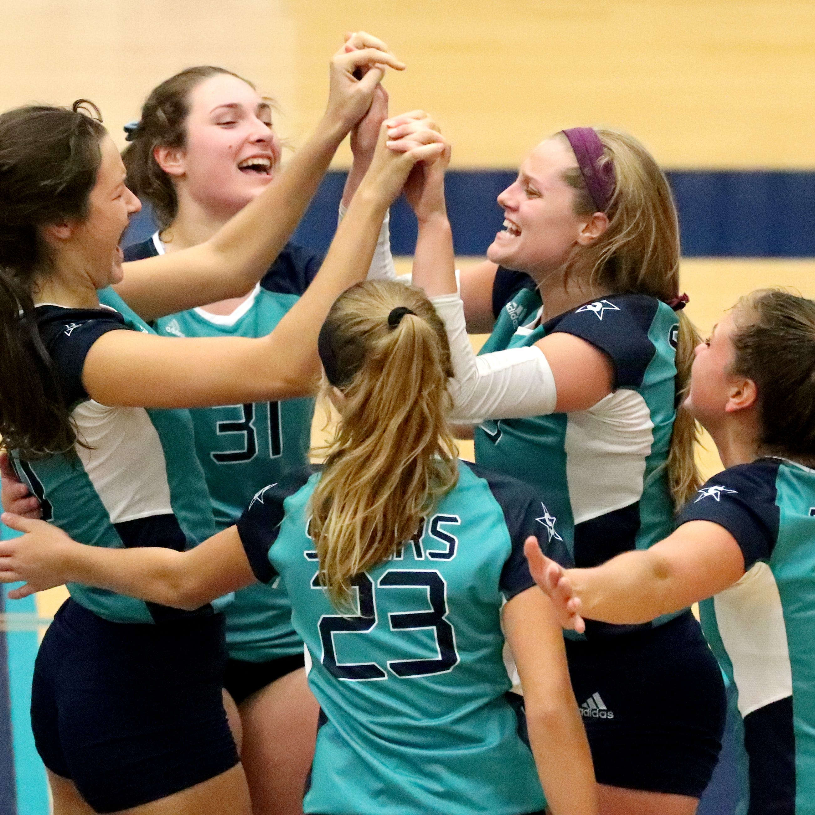 Siegel celebrates its next to last point before beating Heritage in the first round of the TSSAA Class AAA State Girls Volleyball tournament at Siegel, on Tuesday, Oct. 16, 2018.
