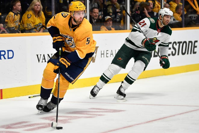 Predators defenseman Dan Hamhuis (5) has seen his playing time increase as injuries have taken a toll on the team.